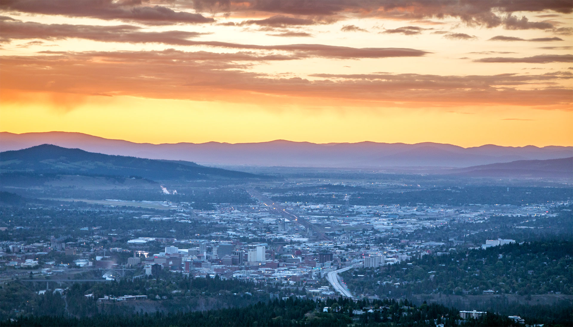 Sunrise looking East over Downtown Spokane from a Helicopter